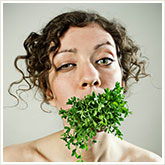 Woman with Salad in Her Mouth