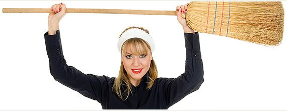 Woman Holding a Broom